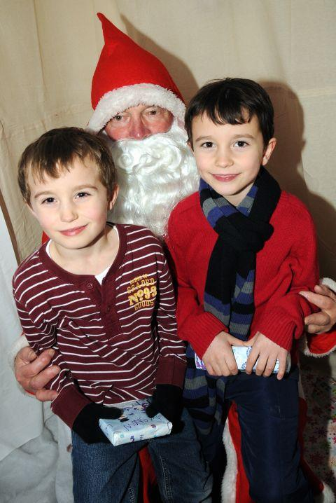 Twins Alex and James Beagrie meet Santa