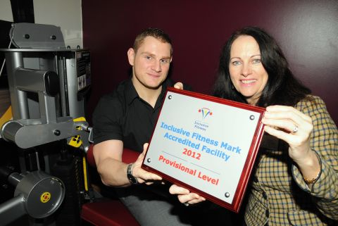 Cllr Elaine Still, Cabinet member for communities, sport and culture, presents the IFI plaque awarded to Basingstoke Aquadrome to gym manager Lloyd Staszkiewicz