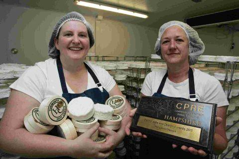 Charlotte Spruce, left, and Stacey Hedges with their award-winning Tunworth cheese
