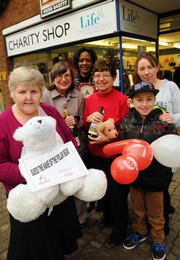 Life shop volunteers celebrate the shop's first birthday