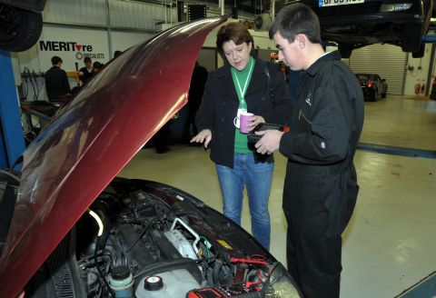 Maria Miller with student Adam Hayes at the BCoT automotive workshop