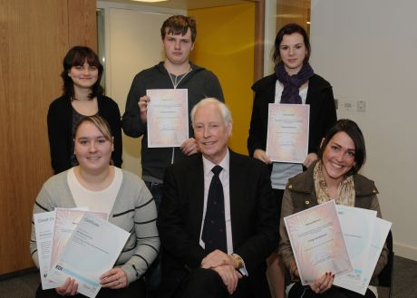 Council leader, Cllr Ken Thornber with (left to right back row): current intern Stacy Burton, and graduates Cameron Smith, Kirsty Hamblett, (front row left to right) Michaela Blaylock, Melissa Mallows