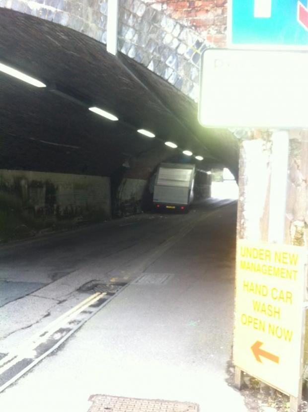 The lorry wedged under the railway bridge at Bunnian Place. Pic by Matt Gregory