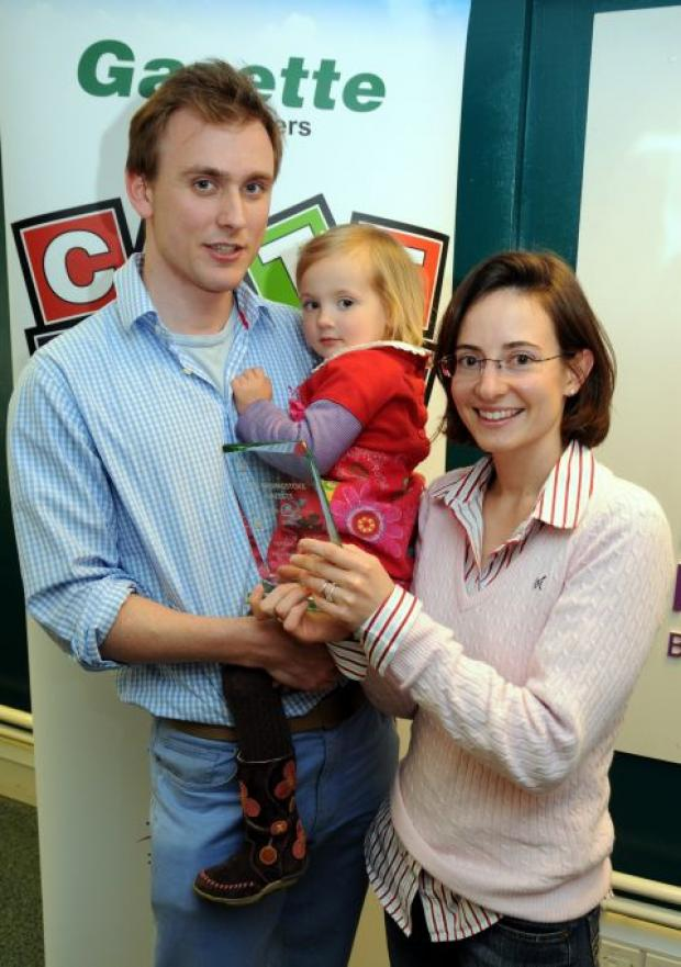 Last year's overall Cute Kids winner Rosanna Macmillan with mum Joanna and dad James