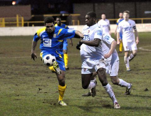 Jordace Holder-Spooner takes on the Staines defence.