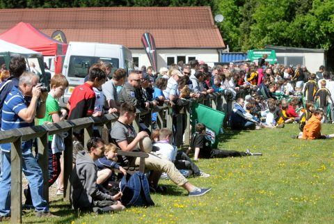 A large crowd watches at Tadley RFC in 2011 as top rugby side London Irish train at the ground
