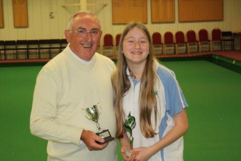 Ray Harris presents the Elaine Harris Trophy to Nicole Rogers.
