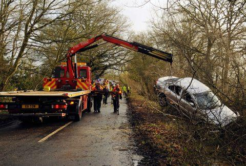 The car being lifted from the ditch in Newnham Lane
