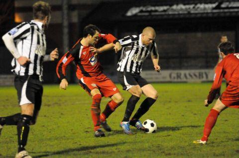 Town goalscorer Stuart Lake challenges Dorchester's Charlie Clough.