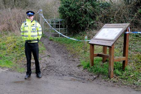 A PCSO guards the entrance to the scene