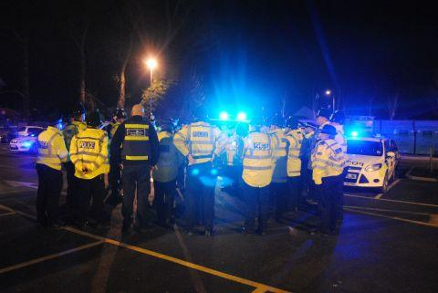 Basingstoke Gazette: Officers are briefed as they arrive in Tadley to take part in Op Surge