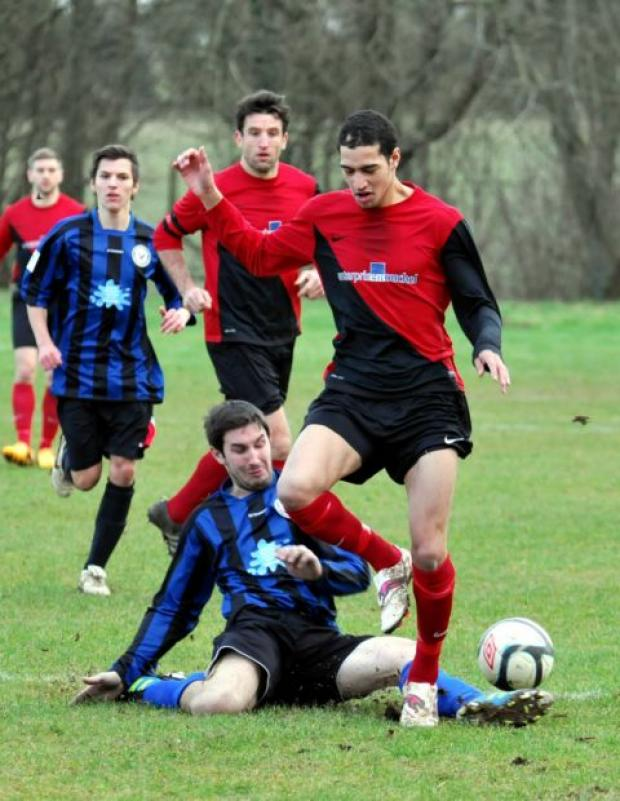 Action from the game between FC Censo (red/black) and Horndean Hawks.