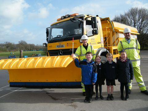 Children from Hook Junior School with Amey drivers Keith Paris and Ian Pearse
