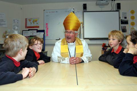The Bishop of Reading, the Right Reverend Andrew Proud, with pupils from Aldermaston Primary School