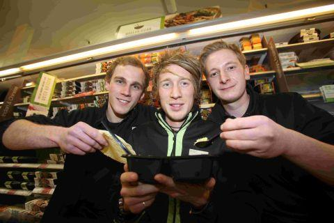 (L-r) M&S employees Tom Richmond, Ashley Soul and Callum Barnes get used to Indian food before cycling more than 2,000 miles across the country by rickshaw