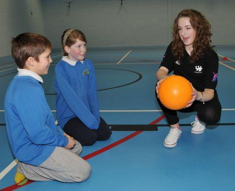 Lydia Rayden coaches Year 6 pupils Kian Gutierrez and Emily Parry, both 10