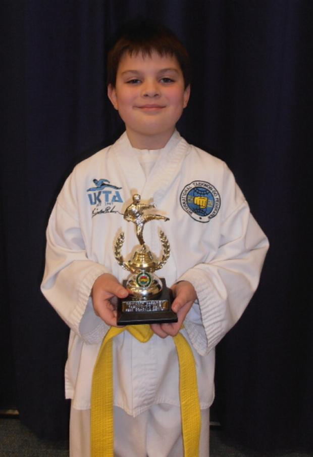 Tidworth Taekwondo's Marcus Kinchlea with his grading award