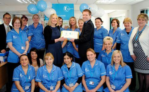 Claire and Norman Murphy celebrate Bluebird Care's first anniversary with staff