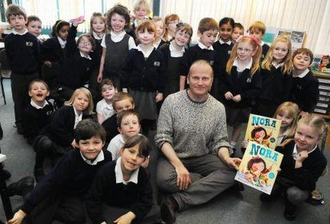 Author Andrew Weale, at Hook Infant School, with Year One children of Dolphins Class