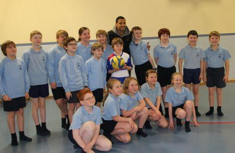Jobi McAnuff with Luca Tonkin, in the Reading top, and pupils