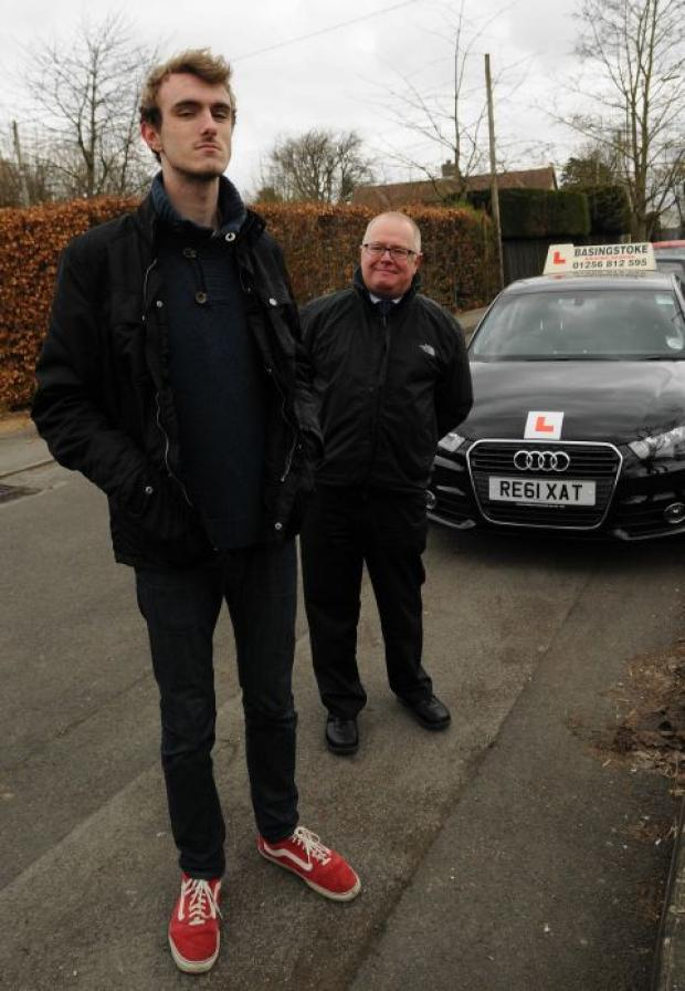 Tall teenager passes his driving test