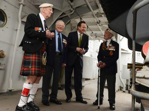 Roy Dykes with David Cameron on the HMS Belfast after being awarded his medal