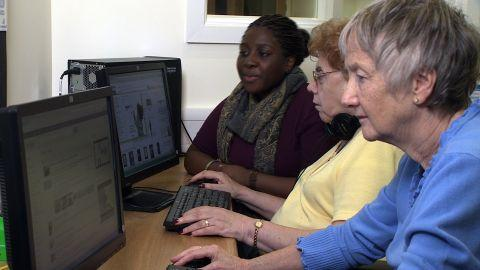 Ariane Tayki, far left, is helping senior citizens to get online