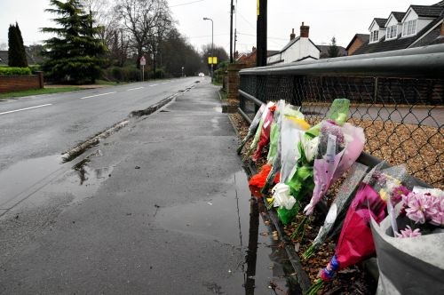 Flowers left at the scene in Silchester Road, following the death of Sam Belcher