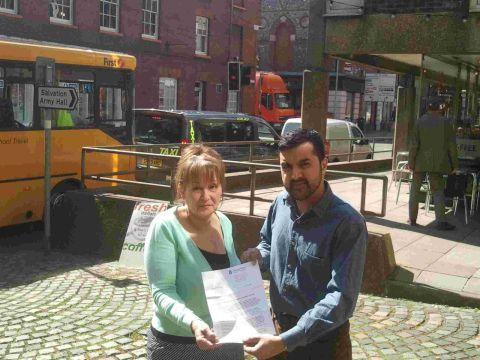 Miff Kayum and Linda O'Connor in St Georges Street with the county council letter