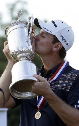 Justin Rose celebrates after winning the US Open last year