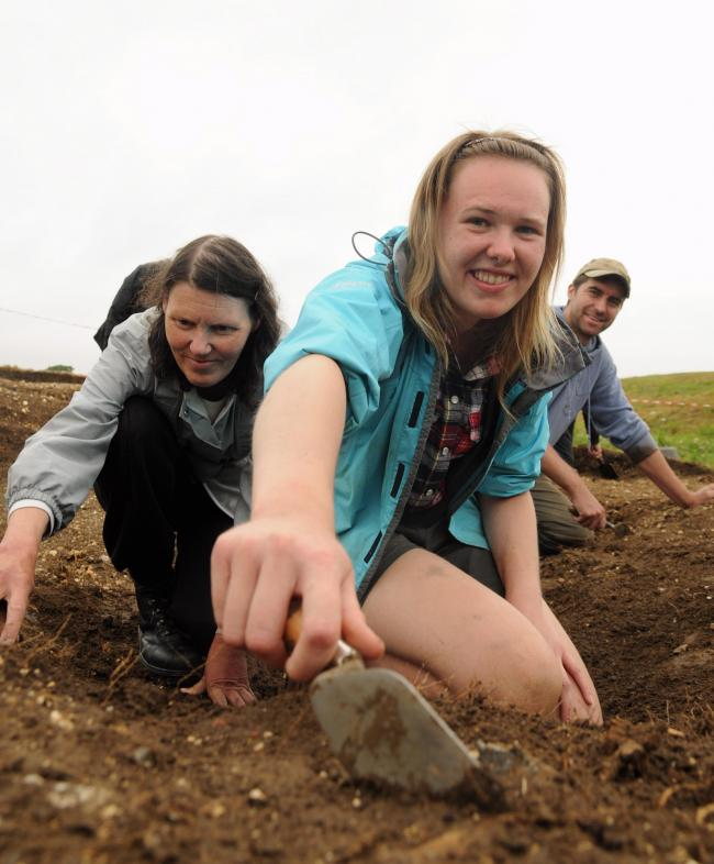 Anne Bruce, Lucy Whitehall and Sam Wilson taking part in the dig