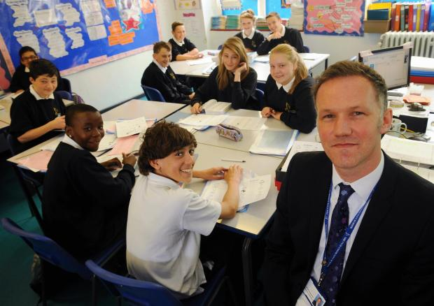 Mark Kingswood with pupils at The Vyne Community School