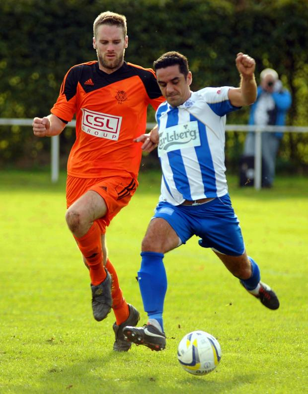 Basingstoke Gazette: Hartley's Shane Hollamby challenges for the ball in the first game between the sides.