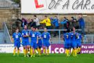 Basingstoke Town players and supporters celebrate the fourth goal, scored by Neil Barrett.