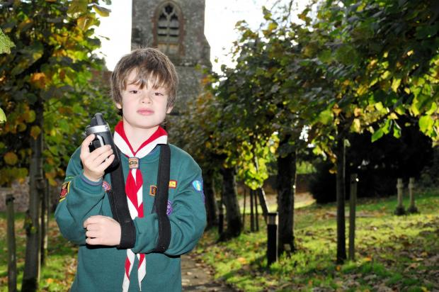 Basingstoke Gazette: Raphael Pinto looks for treasures at St Martin's Church, Ellisfield