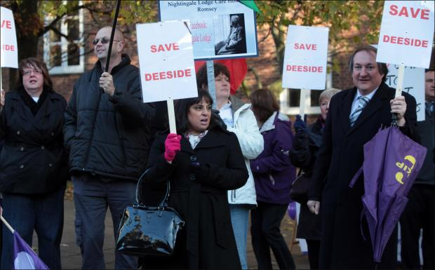 Campaigners protest outside Hampshire County Council.