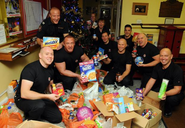 White Watch firefighters from Basingstoke fire station with some of the goodies