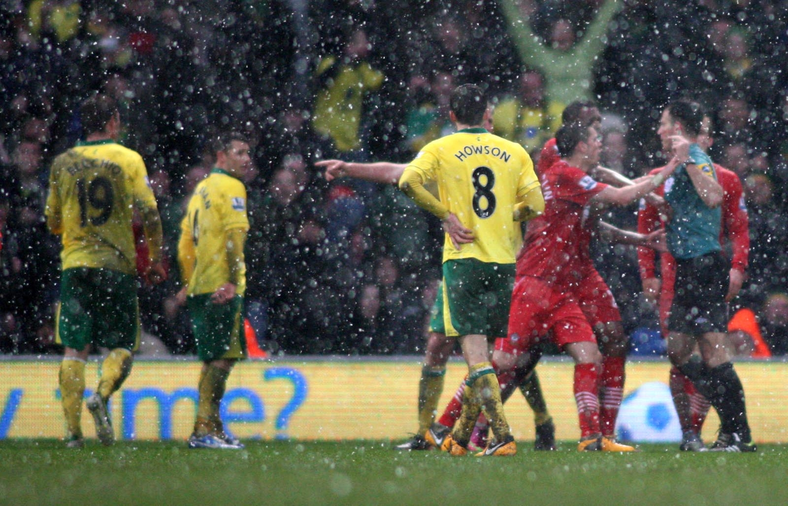 Saints argue with Mark Clattenburg after he awarded a penalty against them at Norwich last season