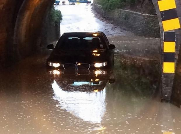 The BMW in flood water in Milkingpen Lane