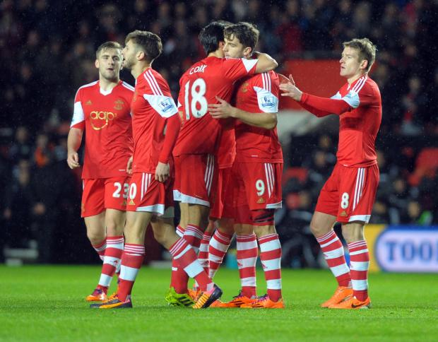 Basingstoke Gazette: Jay Rodriguez is congratulated after scoring against Burnley yesterday.