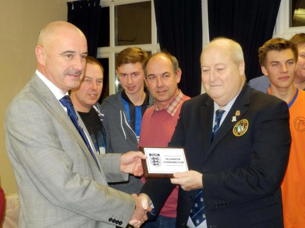 AFC Aldermaston chairman Martin Desay, left, is presented with the Chartered Standard award