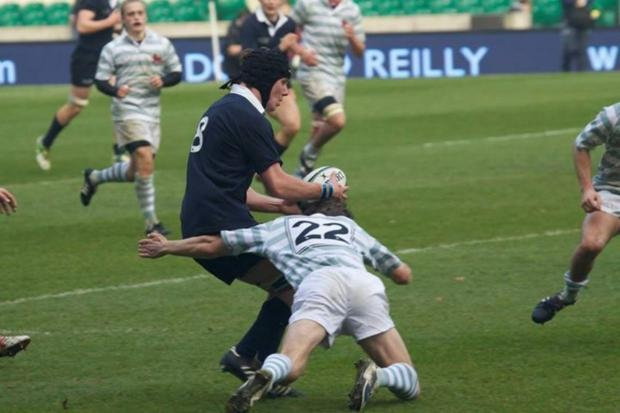 Chris May-Miller makes a tackle at Twickenham.
