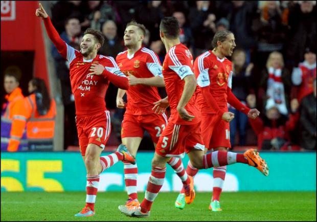Adam Lallana celebrates scoring the winner.