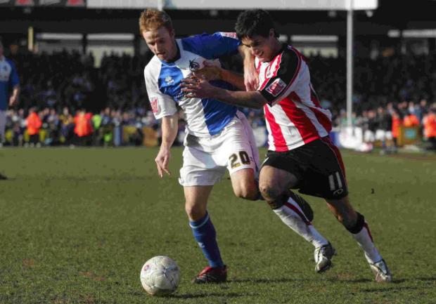 Andrew Surman, right, in action for Saints during the fifth round loss to Bristol Rovers in 2008