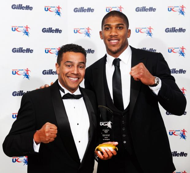 Ex-boxer is made MBE for training