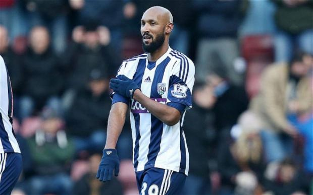 Basingstoke Gazette: Nicolas Anelka celebrates his goal against West Ham with the quenelle gesture.