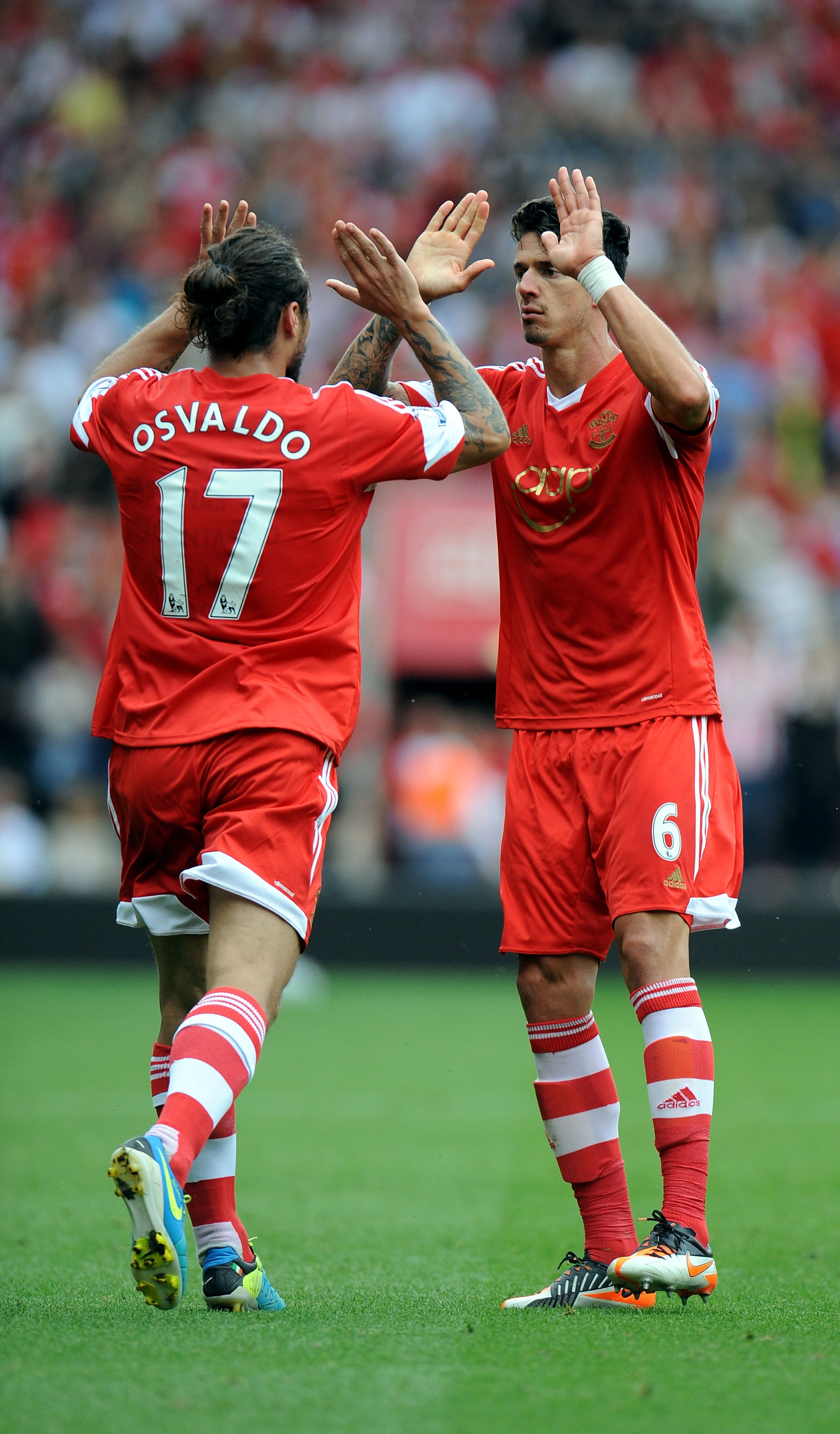 Dani Osvaldo and Jose Fonte in the current Adidas made kit.