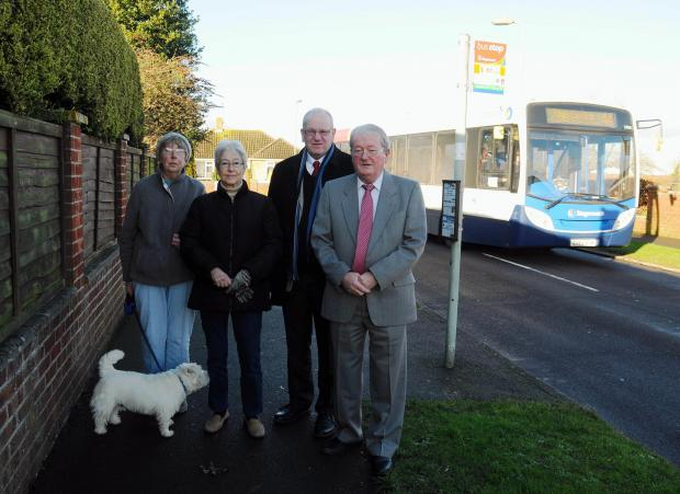 Cllrs Colin Regan and Sean Keating, with bus users Chris Basley and Adrienne Dunford