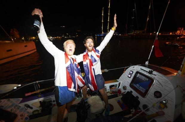 Will North (left) and Dan Howie (right) rowed in on their mighty Blue Steel after 53 days at sea. Credit: jellyfish.co.uk