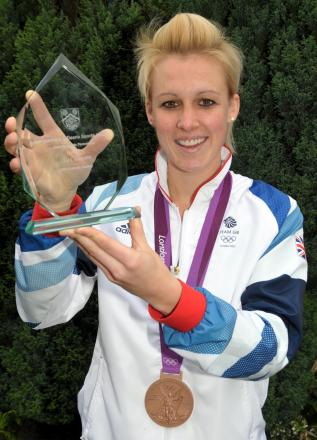Last year's winner, hockey star Alex Danson, with the Gazette Sports Personality of the Year award.